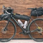 The bicycle packed with a lot of bags and other equipment ready